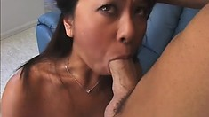 Wild Asian babe slides a dildo in her ass, paving the way for a big cock